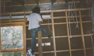 A self-builder works on the wiring of one of the Nubia Way houses in 1996/7 .