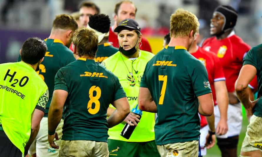 Rassie Erasmus speaks to his players on the field in the first Test.