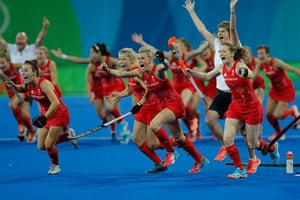 The GB women's hockey team celebrate victory in a penalty shoot-out in the gold medal game against Holland