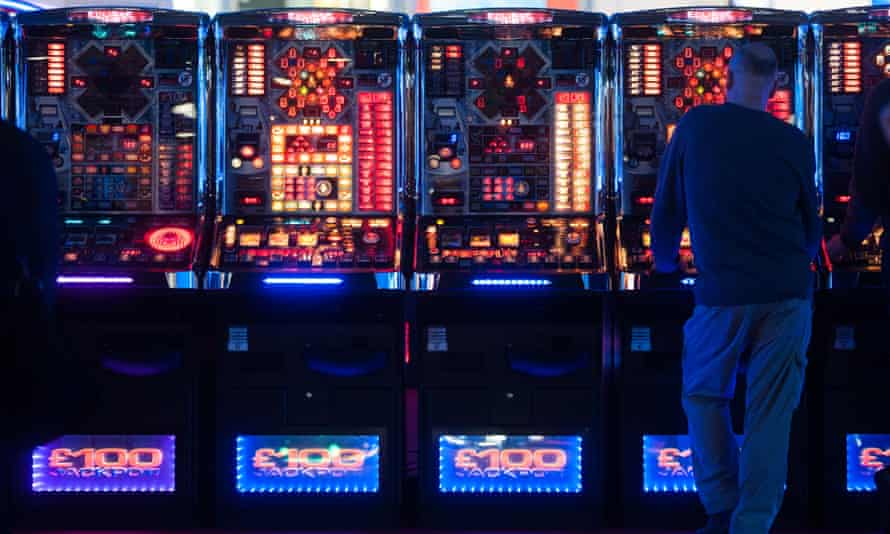 A man plays at slot machines at the ICE Totally Gaming 2014 show, the biggest event in the gaming industry