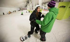 Nadia Khomami gets some snowboarding tuition.
