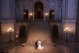 San Francisco, US Eric Lara and Iyah Turminini pose for photos before being married at San Francisco City Hall, which reopened its doors to the public for the first time in 15 months, in California