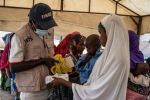 Workers from the World Food Programme conduct malnutrition assessments