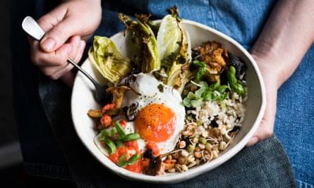 Autumn bowl of brown rice, spring greens, mushrooms, lemon, coconut oil and basil.