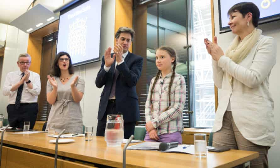 Greta Thunberg is applauded by politicians (from left) Michael Gove, Layla Moran, Ed Miliband and Caroline Lucas.