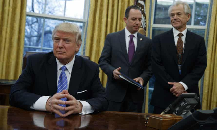 Donald Trump with White House chief of staff Reince Priebus (centre) and National Trade Council adviser Peter Navarro (right).
