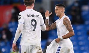 Raphinha of Leeds United celebrates with team mate Patrick Bamford.
