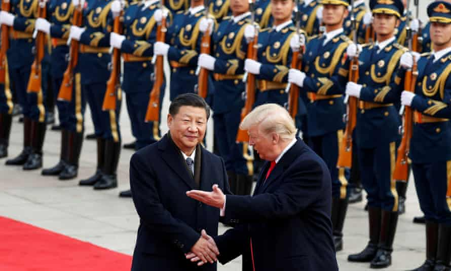 Donald Trump takes part in a welcoming ceremony with China's President Xi Jinping in Beijing in 2017.