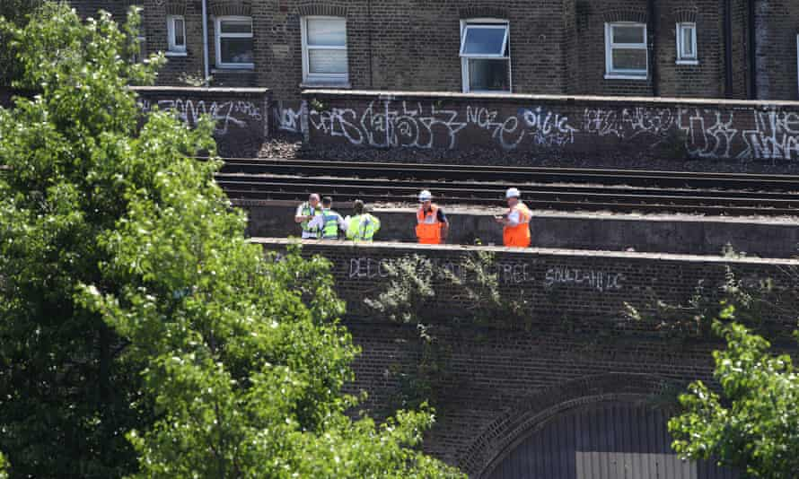 Emergency workers can be seen stood on rail tracks at Loughborough Junction station