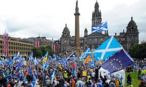 Pro-independence supporters with saltire and EU flags at a rally in George Square, Glasgow, soon after the 2016 Brexit vote.