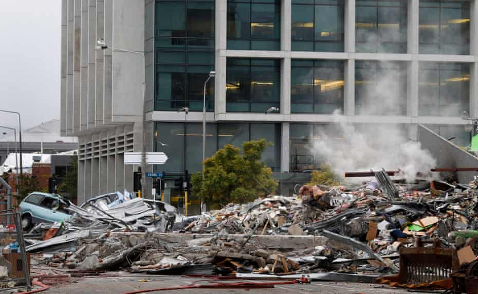 Smoke rises from collapsed CTV building.