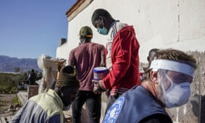 Doctors of the World workers distribute food to migrants from Mali in Nijar, southern Spain.