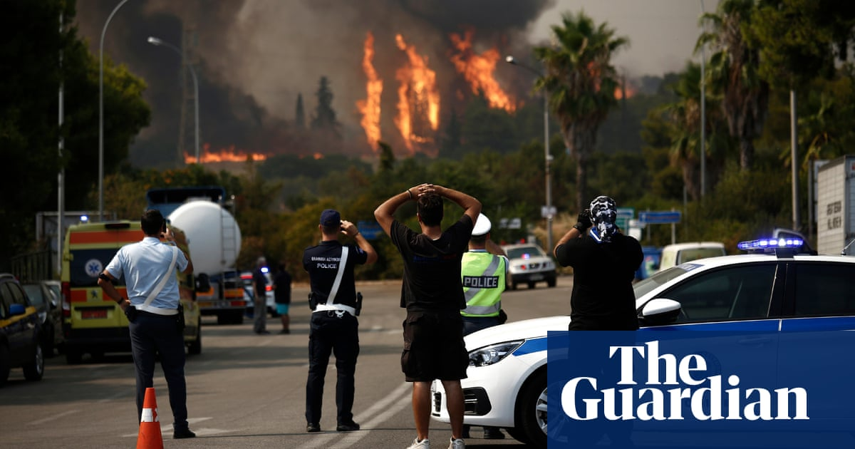 Wildfires reach outskirts of Athens during scorching heatwave