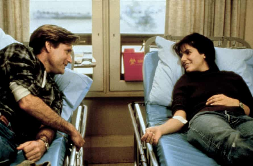 Bill Pullman and Sandra Bullock in While You Were Sleeping.