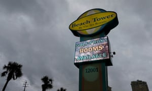 Storm clouds loom over a sign for a beach resort as Hurricane Michael approaches Panama City Beach.
