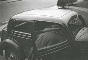 Black-and-white image of an old car.