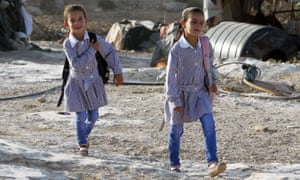 Palestinian girls walk to school in the West Bank village of Susya.