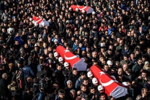 Police officers carry the coffins of comrades during a funeral   at Istanbul's police headquarters a day after bombings