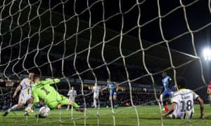 Matt Bloomfield scores Wycombe's second against Burton Albion.
