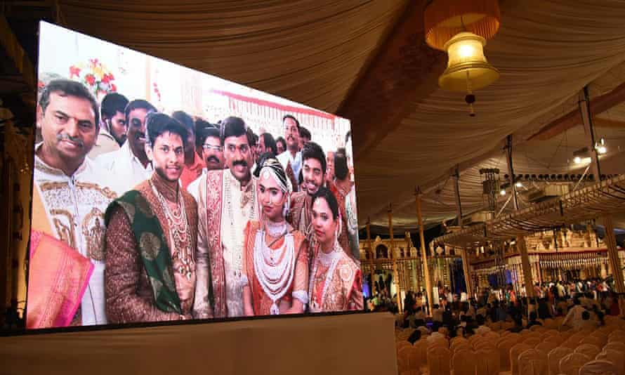 Gali Janardhan Reddy, centre of the screen, with his daughter and son-in-law during the wedding.