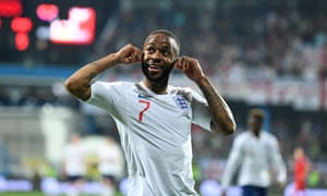 Raheem Sterling gestures to the home fans after scoring England's fifth. Reports from the ground suggest Sterling and others were subjected to racial abuse from the stands.