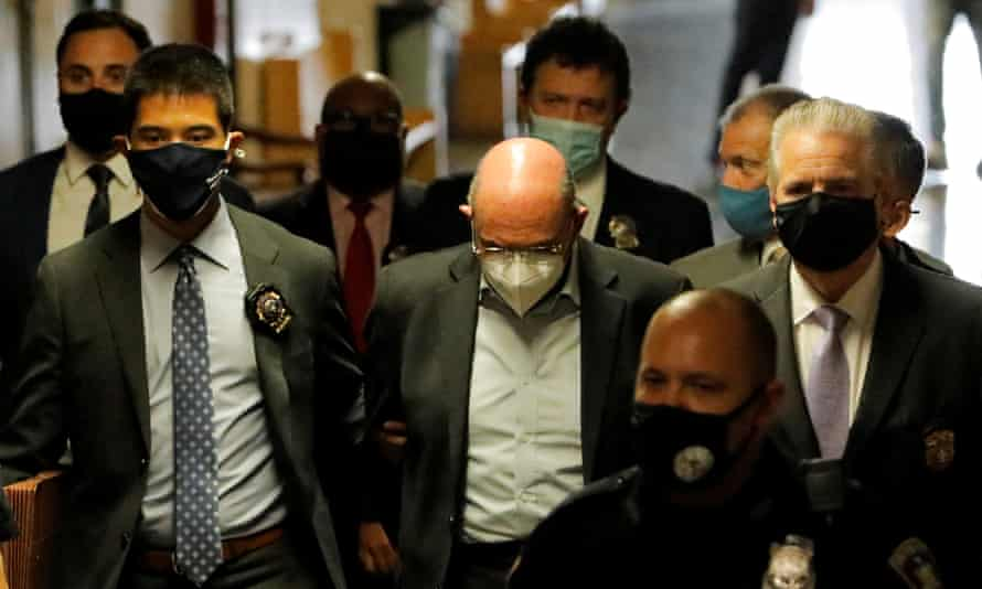 Allen Weisselberg is escorted to his arraignment hearing in New York City on 1 July.