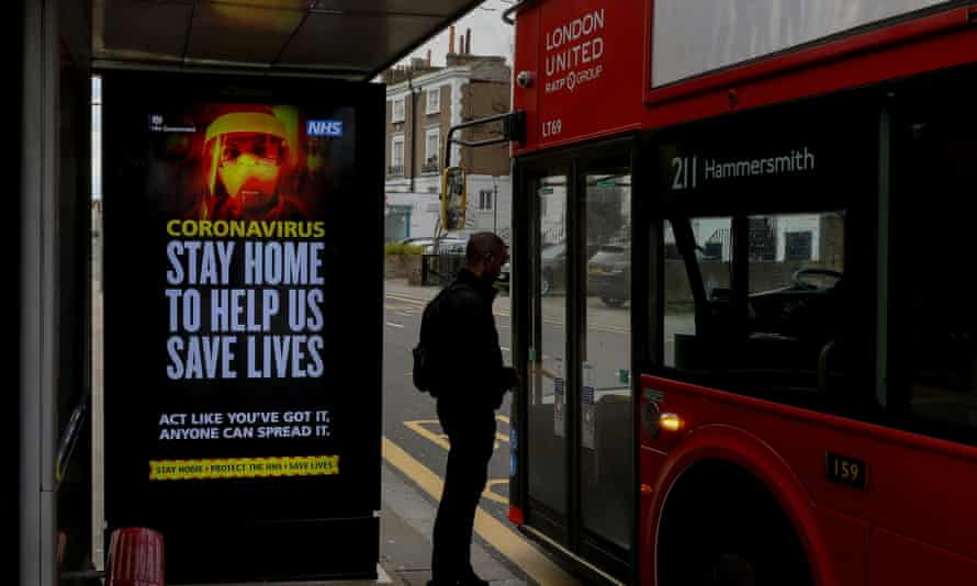 A UK government warning is seen at a bus stop in London.