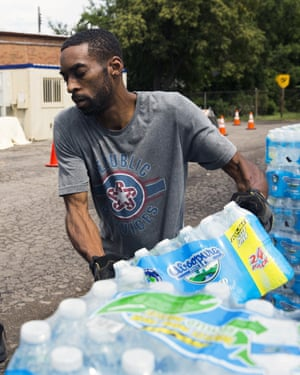 A volunteer distributes water at a church in Flint, Michigan, in 2017.