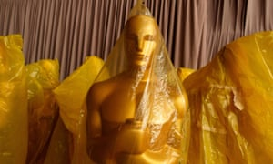 A picture of an Oscar statuette wrapped in gold plastic