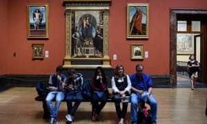 Visitors sit in one of the few rooms open at the National Gallery.