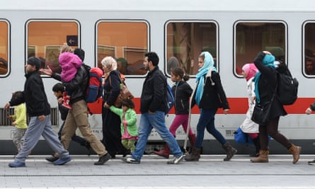 Refugees arrive at the central railway station in Passau, southern Germany.