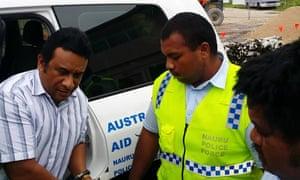 Nauru MP Mathew Batsiua in handcuffs