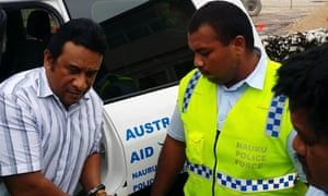 A member of the 'Nauru 19', opposition MP Mathew Batsiua, is led into court in 2015 charged with 'disrupting the legislature'