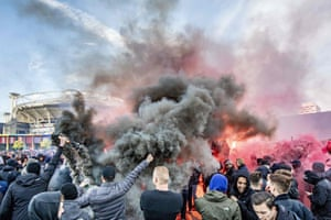 Ajax fans wave flares outside the Johan Cruijff Arena