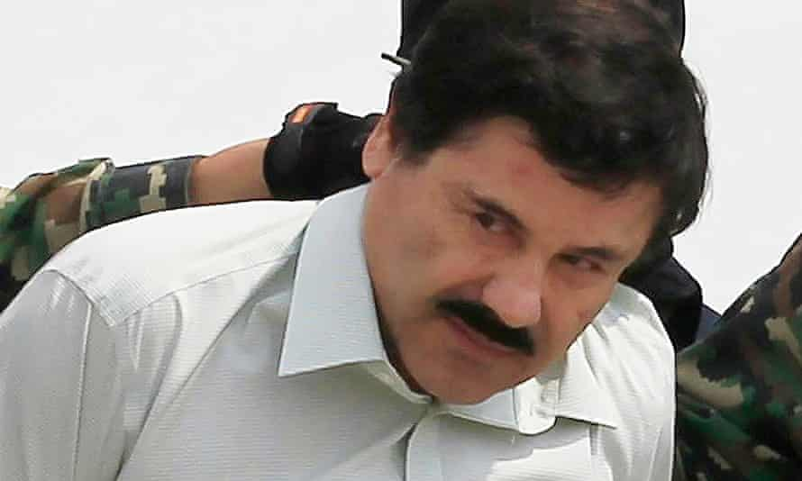 Joaquin 'El Chapo' Guzmán is escorted by soldiers after a previous capture on 22 February 2014.