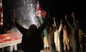 Supporters of Pakistan's Pasban Democratic party celebrate the shooting down of Indian fighter jets