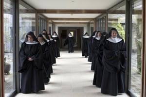 Nuns process to prayer