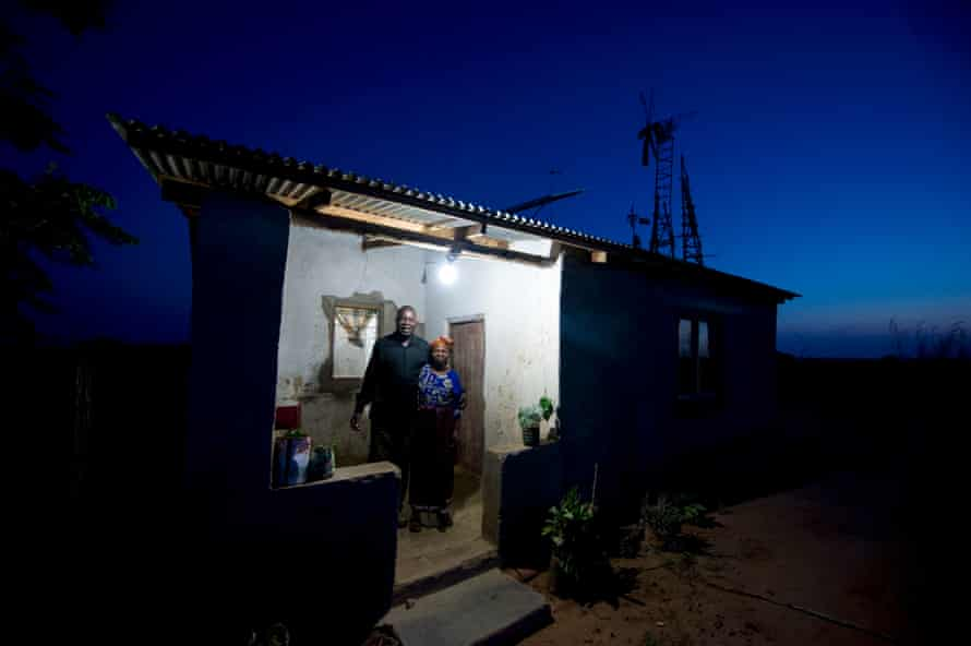 A family in Wimbe, central Malawi, on a remote farm powered by a series of windmills and solar panels