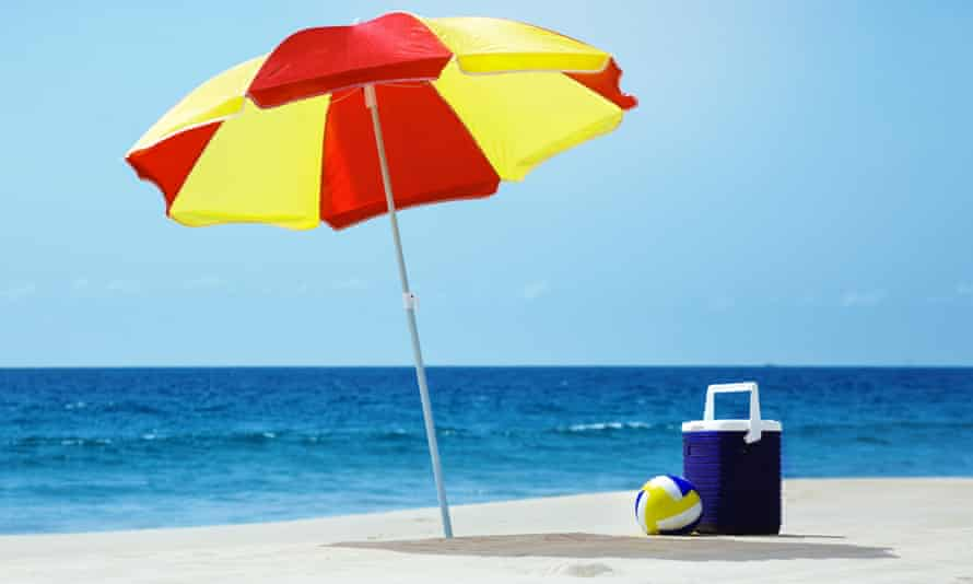 Empty beach with umbrella and accessories
