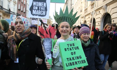 People take part in the Women's March in London in January to advocate equal rights.