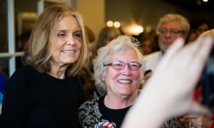 Feminist writer and activist Gloria Steinem (left) poses for a photograph with a fan after delivering a speech in support of Democratic presidential candidate Hillary Clinton at Live Juice shop in Concord, New Hampshire, on January 29, 2016. Photograph: Bastien Inzaurralde for the Guardian.
