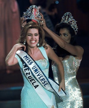 Alicia Machado of Venezuela reacts as she is crowned Miss Universe on 17 May 1996.