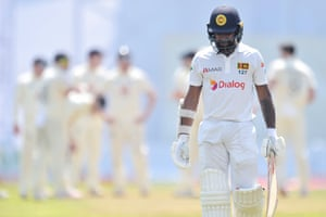 Niroshan Dickwella heads off the field after his wicket was taken by Jimmy Anderson.
