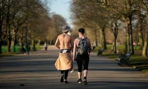 People enjoy the afternoon sunshine in Regent's Park, London