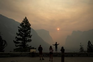 Yosemite, US: People pose for photos as smoke from the Ferguson fire fills Yosemite Valley
