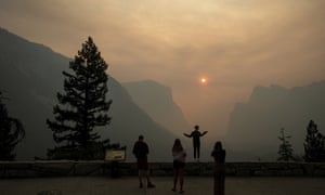 Smoke from the nearby Ferguson fire fills the Yosemite valley, which has been emptied of tourists.