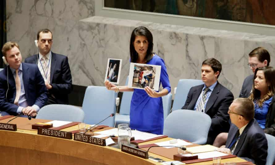 Nikki Haley, the US ambassador to the United Nations, holds up pictures of victims of a chemical attack in Syria during an emergency meeting of the UN security council on 5 April.