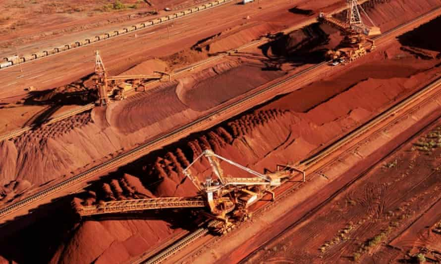 Iron ore being stockpiled for export at Port Hedland in Western Australia. BHP Billiton is on the cusp of destroying 86 Indigenous sites in the central Pilbara to expand its South Flank iron ore mining operation.