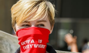 "Stop the Hate Rally, Toronto, Canada - 11 Aug 2018Mandatory Credit: Photo by Shawn Goldberg/REX/Shutterstock (9788272ai) Woman wearing red bandana over face that reads ""ANTIFA IS EVERYWHERE"". Stop the Hate Rally, Toronto, Canada - 11 Aug 2018"