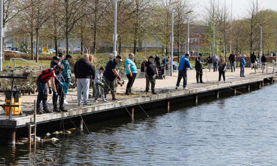 Members of the Glasgow Magnet Fishing group on a busy promenade